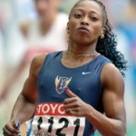 Мускулистая спортсменка. Женщина спринтер.