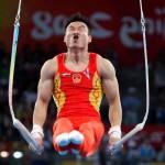 Китаец Янг Вей гимнаст на кольцах
